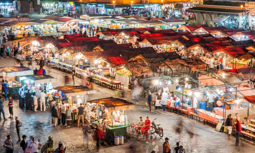 Dusk view of food stalls and crowds in Jemaa El Fna Square in Marrakech, Morocco