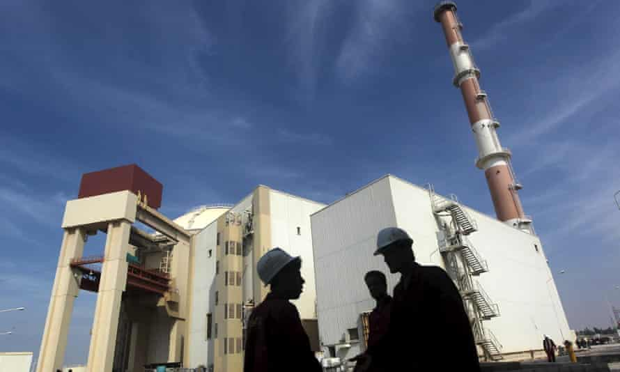 Iranian workers stand in front of the Bushehr nuclear power plant in Iran.