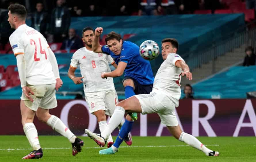 Federico Chiesa curls the ball into the far corner to put Italy ahead.