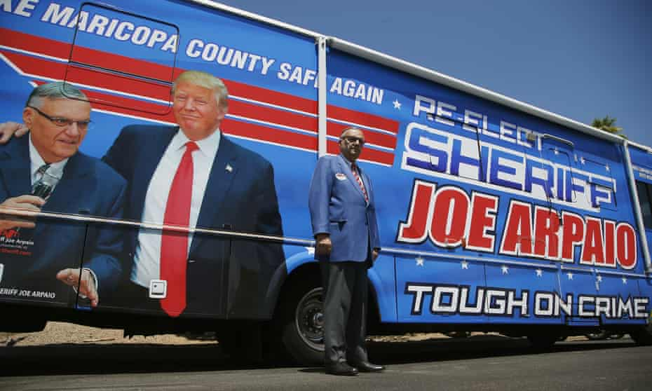 Joe Arpaio in front of a 2020 campaign car.