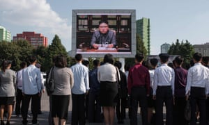 Spectators listen to Kim Jong-Un outside the central railway station in Pyongyang.