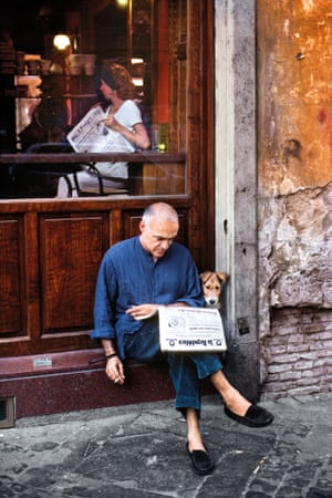 Man Reads Newspaper with Dog. Rome, Italy, 1994.