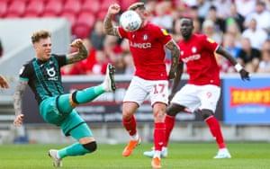 Swansea's Joe Rodon stretches to reach the ball against Bristol City.