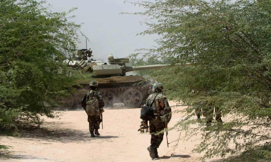 Ugandan peacekeepers from Amisom in Somalia, where dozens were killed on Sunday