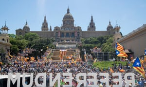 A crowd estimated at 40,000 listens to speakers at the rally on the steps of Montjuïc in Barcelona.