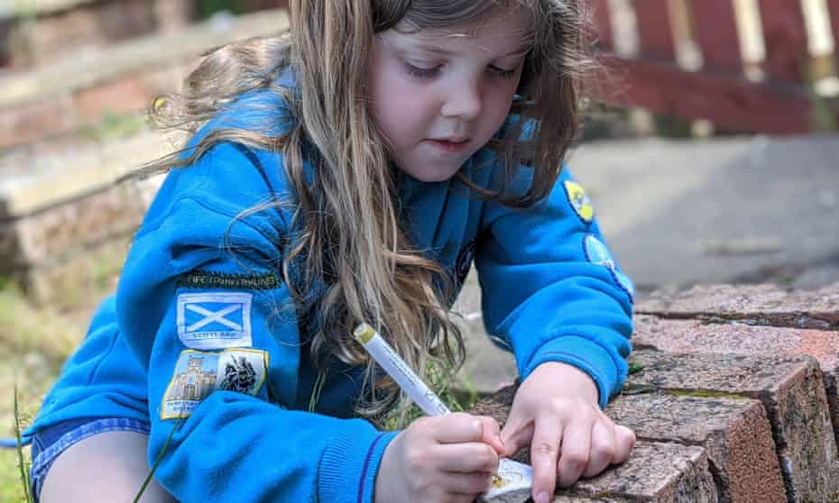 Jessica McCulloch, 7, a Beaver Scout from Dunfermline writes a message on a pebble for her local care home.