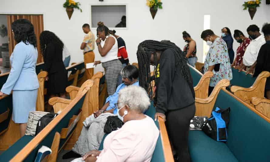 Congregants of Bethesda Worship and Healing Center pray during Sunday service.