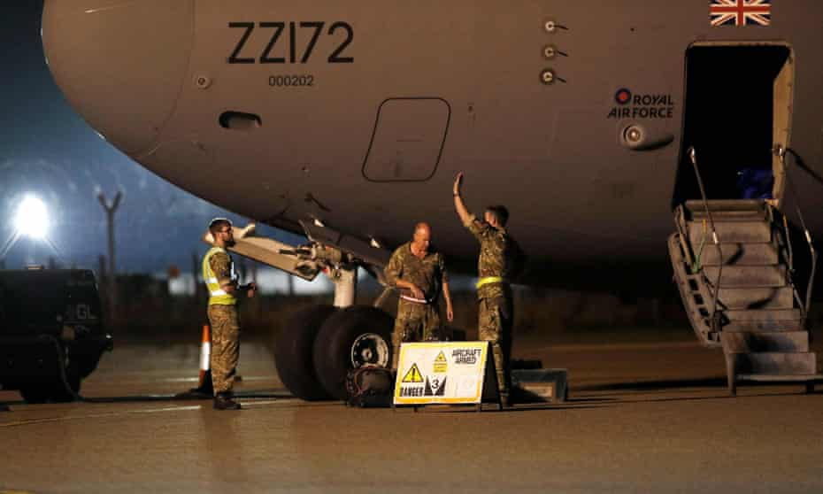Armed forces personnel disembark an RAF aircraft at Brize Norton