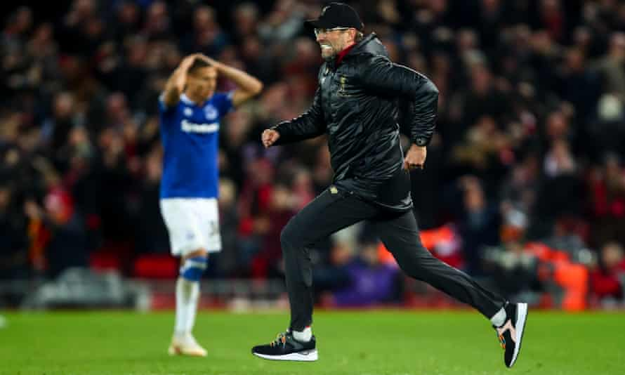 Jürgen Klopp dashes across the pitch after Liverpool scored a late winner to celebrate with his goalkeeper, Alisson.