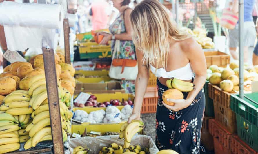 Shopping for fresh fruit at Parap village markets.