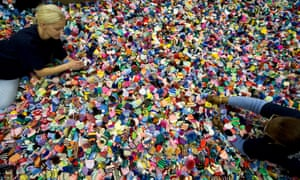 workers sort through tiny bobble hats