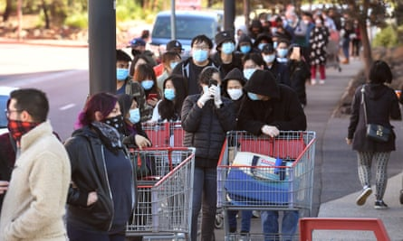 Shoppers in the Australian city of Melbourne form a queue outside a supermarket as they prepare for stage 4 restrictions.