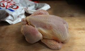 Tesco bag with stock image of a raw chicken