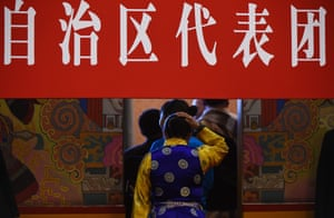 A Tibetan delegate leaves a group meeting