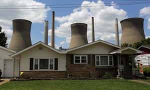 Coal-fired power plant is seen behind a home