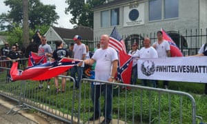 In this Sunday, Aug. 21, 2016, photo, people with a White Lives Matter sign demonstrate in front of the NAACP office in Houston, Texas. (Darla Guillen/Houston Chronicle via AP)