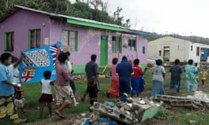 Villagers of Nasau, Koro, Lomaiviti, one of the areas worst affected by Tropical Cyclone Winston, celebrate after Fiji won gold in the men's rugby sevens at the Rio Olympics.