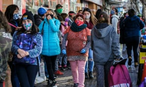 People queue at a supermarket in the coastal city of Valparaiso