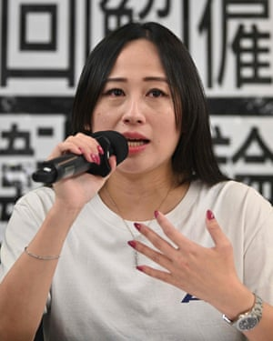 Rebecca Sy, who was dismissed as chair of the flight attendants union at Cathay Dragon, speaks at a press conference in Hong Kong