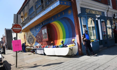 Shoppers pick from a colourful hat collection along Baltimore's Monument Street shopping district.
