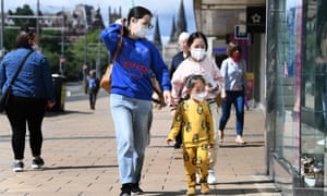 Members of the public wear face masks as they shop on Princes Street