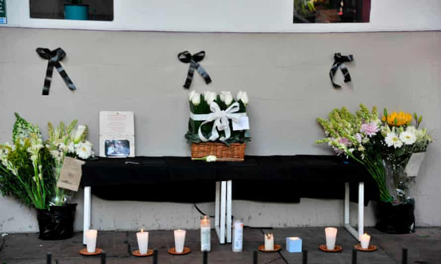 An improvised altar set up by employees of the restaurant owned by Baptiste Lormand after he was found murdered in Mexico City on 29 November.