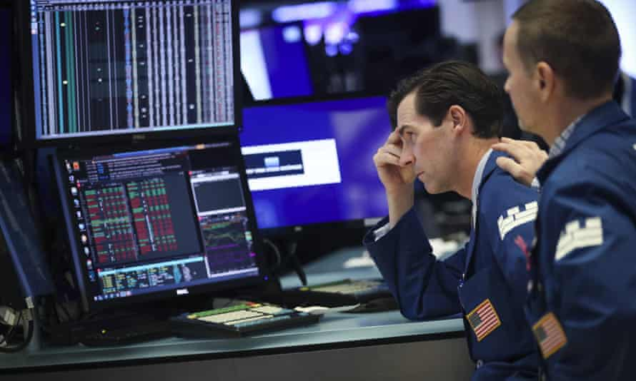 Wall Street traders watched the markets plunge after Trump announced new tariffs on Thursday.