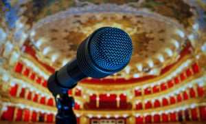 A microphone on a theatre stage