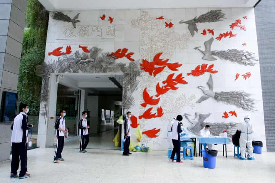 pupils are tested before their return to high school, hubei province, china, late last month