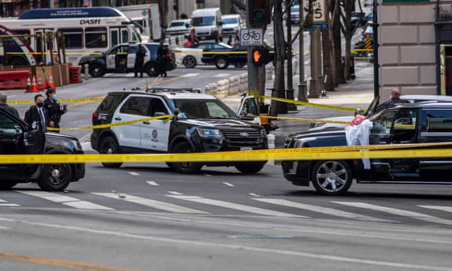 Police investigate the scene of shooting at 7th and Figueroa Streets in downtown Los Angeles.