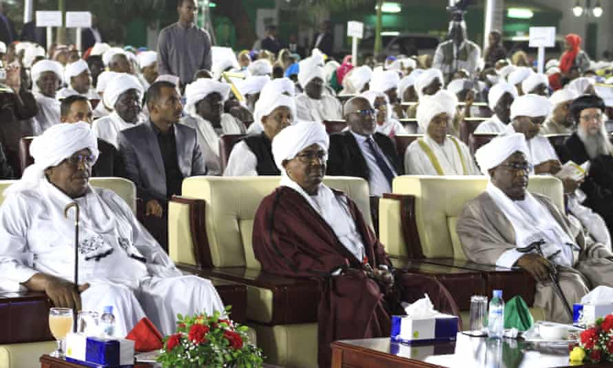 Sudanese resident Omar al-Bashir, center, attends a celebration to mark the 61st anniversary of Sudan's independence from Britain on 31 December.