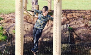 Young boy on an obstacle course at the Bear Trail, Devon.