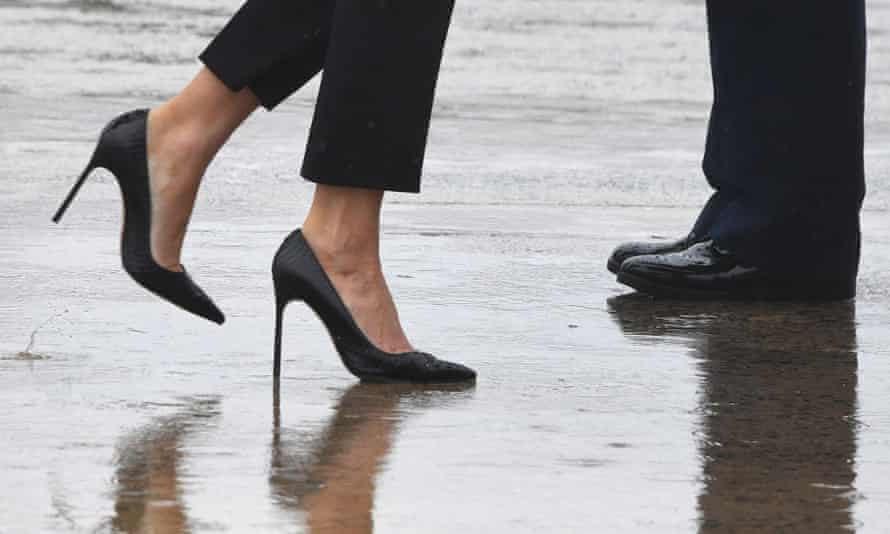 Melania Trump walks in high heels to board Air Force One in Maryland.