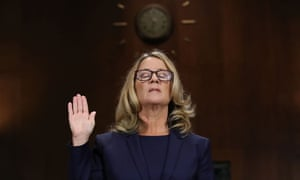 Christine Blasey Ford is sworn in before testifying the Senate judiciary committee on Capitol Hill on 27 September.