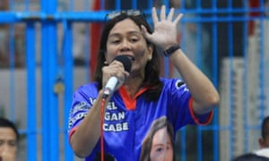 Gertrudes Batocabe (R), wife of the late congressman Rodel Batocabe, speaking during a campaign rally in the town of Daraga, Albay province, south of Manila, philippines