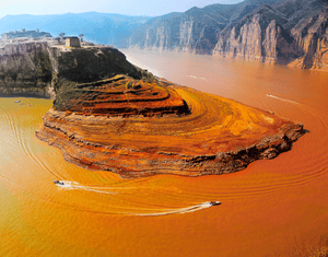 Yellow river, ChinaThis is the third-longest river in Asia, and the most silt-laden river on Earth. It takes its name from coloration by the fine, wind-blown sediment, known as loess, that it carries along its lower course. The river flows through deep gorges, as seen in the image, before it descends on to the North China Plain.