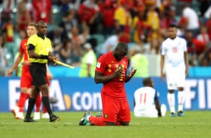 Lukaku drops to his knees and prays at the final whistle.