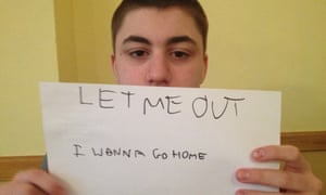 Matthew Garnett holds sign saying let me go out, I want to go home