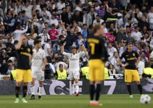 The Atletico players look dejected after the third goal for Real.