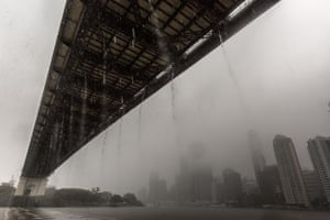 Rainwater flows off of the Story Bridge and into the Brisbane River.