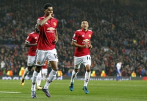 Rashford celebrates scoring the third.