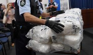 An Australian federal police officer with a seized haul of crystal methamphetamine.