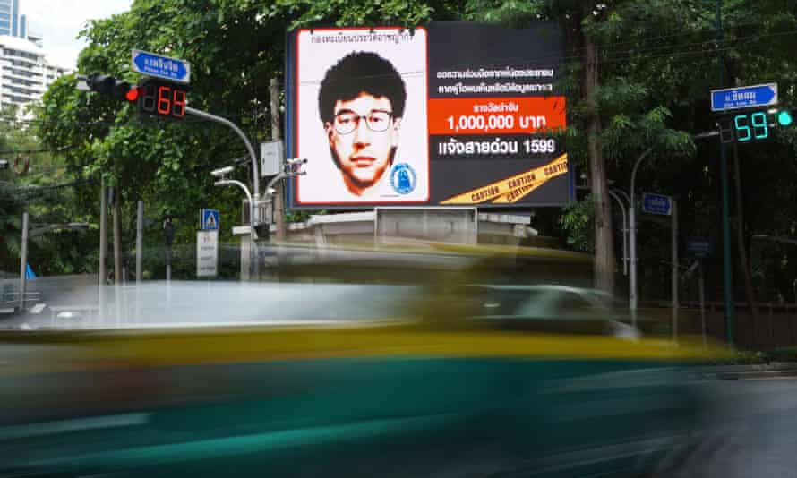 A digital billboard in Bangkok shows a sketch of a man suspected of involvement in Monday's bombing.