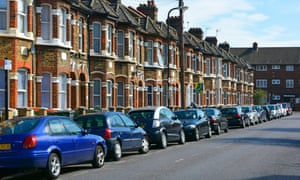 Terraced housing with residents cars parked outside