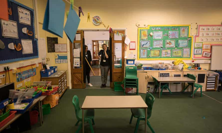 The headteacher and a teaching assistant work to provide a safe class environment at a school near Huddersfield.