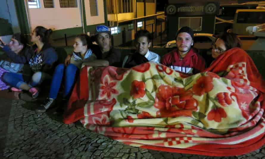 Fans gather outside Chapecoense's stadium on Tuesday night to mourn the club's players.