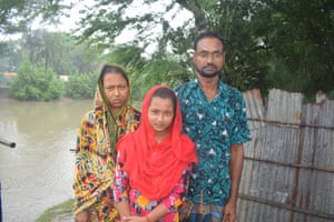 Farmer Faruk Hossain, who is moving from Chakla village to the city of Khulna with his wife Farida Yasmin and daughter.