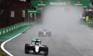 Lewis Hamilton leads Nico Rosberg during a very wet Brazilian F1 Grand Prix