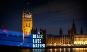 Black Lives Matter is projected onto the Houses of Parliament.