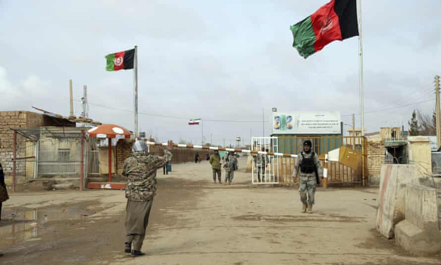 Afghan border police guard the Islam Qala crossing into Iran